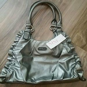 Nine and Company silver handbag